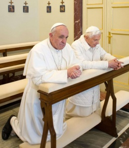 Popes Francis and Benedict XVI in prayer