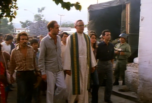 Romero leads the procession into the church at Aguilares