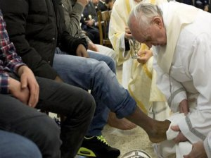 Pope Francis washing feet on Holy Thursday