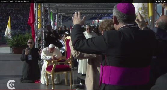 Pope Francis Kneels as Charismatic Catholics Pray Over Him, via Catholic News Service, 6/2/14