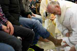 Pope Francis washing the feet of youth detainees on Holy Thursday.