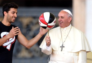 Pope Francis plays with a basketball during the Italian Catholic Sports Centre (CSI) 70th anniversary celebrations, on June 7, 2014, in St Peter's Square, at the Vatican. (credit: ALBERTO PIZZOLI/AFP/Getty Images)