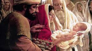 Simeon embraces the baby Jesus in the temple.