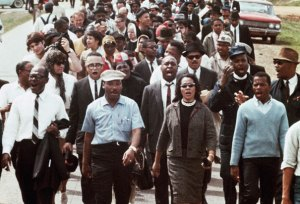 Dr. Martin Luther King and Coretta Scott King lead the Selma to Montgomery March, 1965.