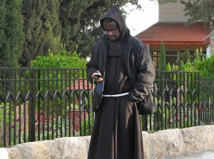 A monk texting (photo courtesy of Simple Folower of Jesus)