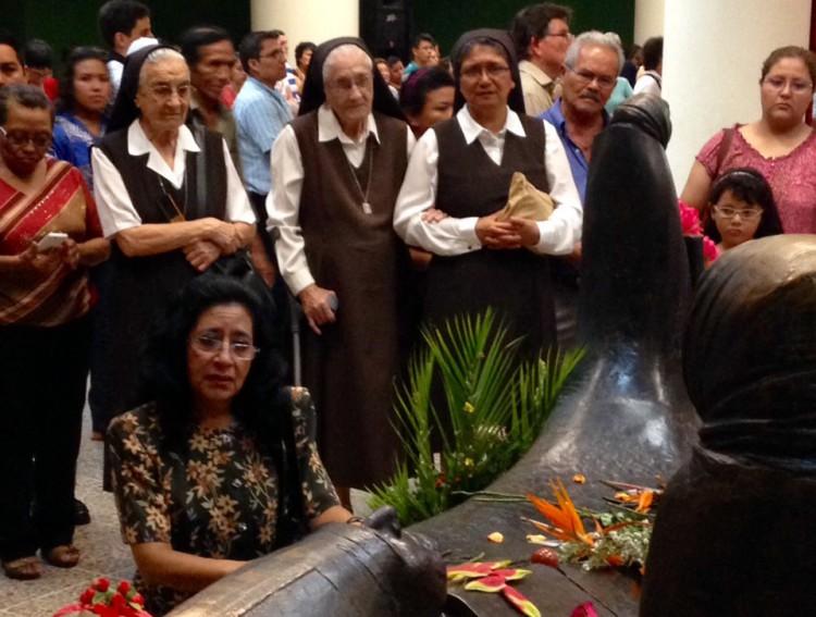 praying at tomb