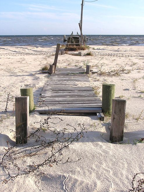 A broken pier on the beach in Waveland. By photographer Shawn Lea from Jackson, MS, US.