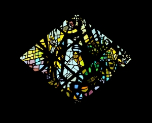 Image of St. Dominic with the star in his hand from the Queen of the Most Holy Rosary Chapel at the Sinsinawa Dominican Mound.  http://www.sinsinawa.org/qrcwindows/qrcwindows-west.html