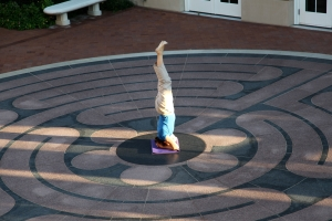 Prof. Susanne Scholz, doing yoga in the center of a labyrinth