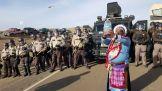 http://www.motherjones.com/files/imagecache/top-of-content-image/protester-water-cops2000.jpg